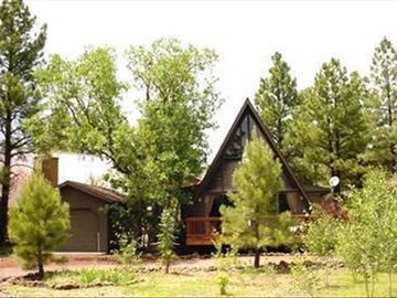 Munds Park cabin rental - A-frame with floor to ceiling windows and single car garage