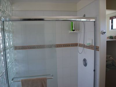 Tiled shower with southwest flair.