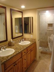 Dana Point condo photo - Master bathroom with granite counters and walk-in travertine shower
