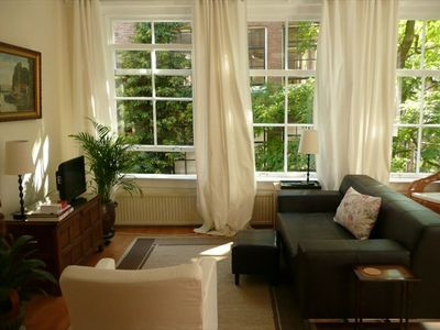 East Amsterdam apartment rental - Living room photos are taken at different times w/ different arrangement
