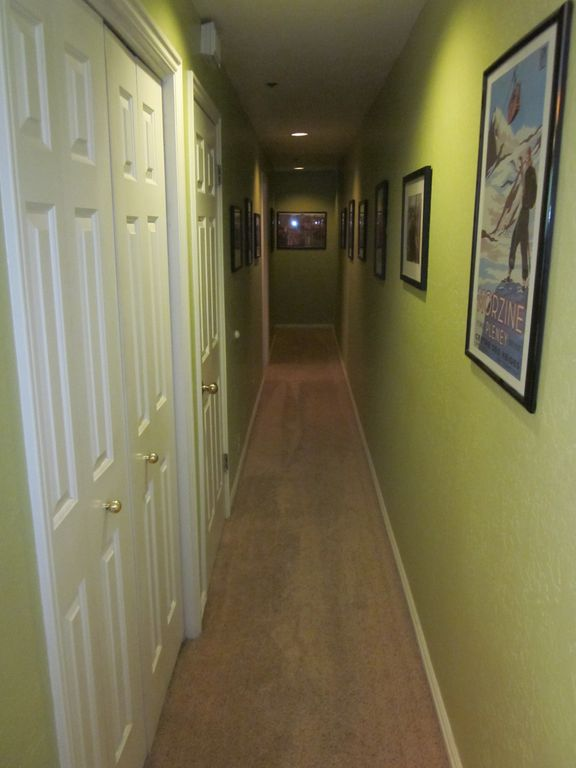 Hallway with pictures on the walls