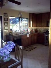Carlsbad house photo - Fully Stocked Kitchen with brkfst table, TV, appliances, travertine & granite!