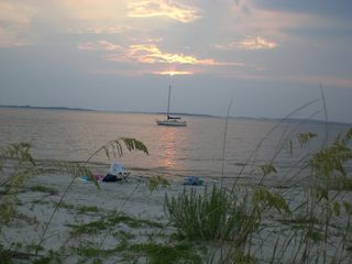 Sunset and sailboat - Tybee Island cottage vacation rental photo