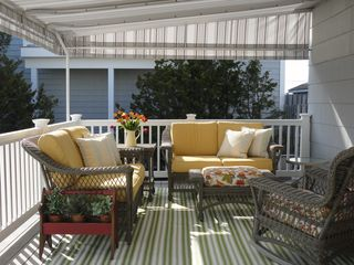 Avalon cottage photo - Comfortable covered back deck seating with outdoor carpet