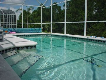 Oversized heated pool with fully screen enclosure