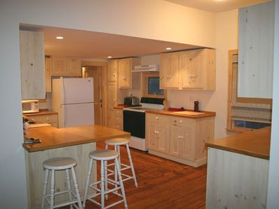 Large, airy kitchen with gleaming pine floors. Counter for coffee or apperitif!