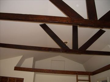 High Ceilings with Dark Wood Beams