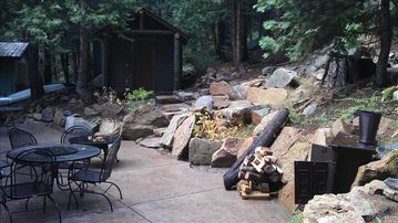 Back patio: 2 patio sets for 8 people, Gas BBQ, Log cabin sauna and fire pits