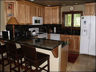 Avon townhome photo - Kitchen - Granite Counters Bar Seating for 3