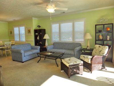 Beautiful 3 Bedroom 3 Bath Condo with lots of Amenities to Enjoy including a Golf Cart !