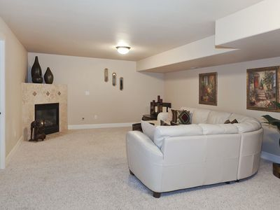 LOWER FLOOR LIVING ROOM WITH FIREPLACE