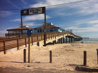 North Padre Island condo photo - Bob Hall Pier for fishing or burgers about a mile down the beach