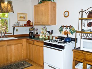 Wood Valley Pahala cottage photo - Fully equipped kitchen with everything you need to prepare meals.