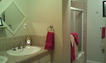 Spaciously oversized main Full bath with rain shower, 3 feet bench, dual sinks