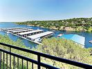 Balcony - The covered balcony offers unparalleled views of Lake Travis and Texas Hills.