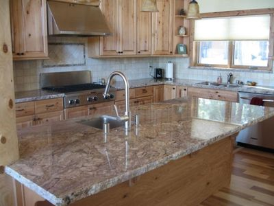 Note the handcrafted chisled granite edge in the Gourmet Stainless Kitchen