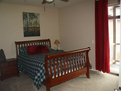 Master Bedroom: queen bed with private bath and patio