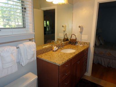 Shared bathroom for twin and queen bedrooms with tub/shower combo.