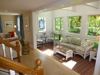 Biddeford house photo - 2-story sunroom with skylights flows into living room and dining room.