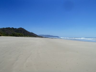 Playa Hermosa beach with views towards Mal Pais and Cabo Blano Nature Reserve.
