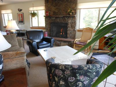 Gas fireplace and comfortable seating in spacious great room.