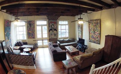 Feast your eyes on your ultimate getaway! 16' ceilings, original NOLA artwork!