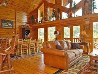 Families Create Memories in the Living & Dining Area - Pigeon Forge cabin vacation rental photo