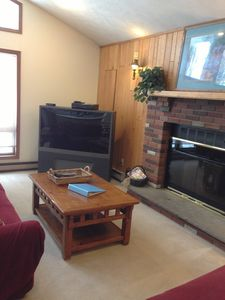 large screen TV & gas fireplace