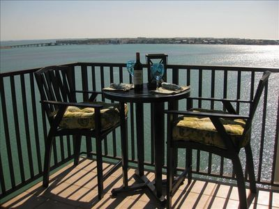 Boca Ciega Bay sparkles as you enjoy a refreshing drink at our  new bistro set