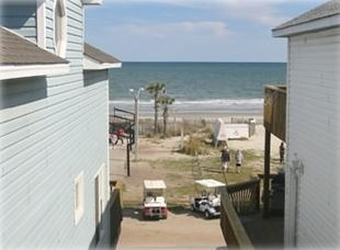 View of beach from upstairs deck