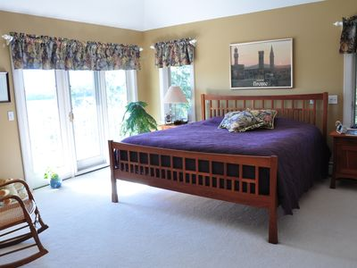 Master bedroom with private deck and amazing lake views. King size bed.