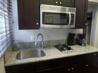 Stainless steel appliances & granite countertop. Cute & practical.