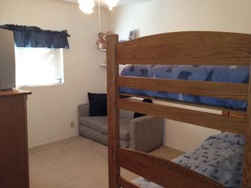 Kids get their own room; 3 twin bunks (w/trundle), fold-out futon. TV w/VCR/DVD