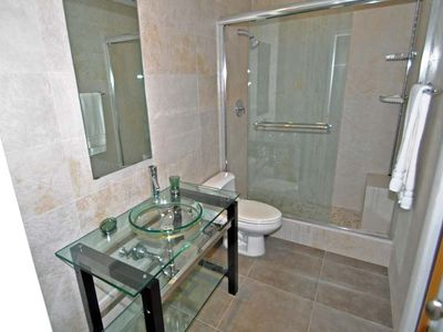 Sanibel Island condo rental - Guest Bathroom with walk-in shower and custom fixtures.