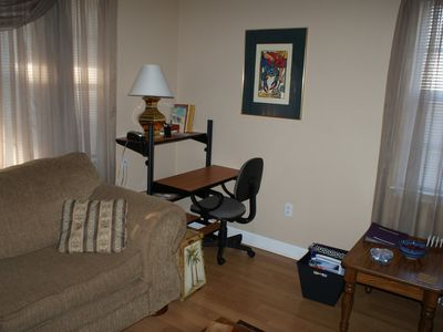 Living room has office space area. wireless internet included.