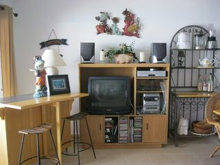 DirecTV, Stereo with CD's, DVD & VHS player along with movies and tapes - Bimini condo vacation rental photo