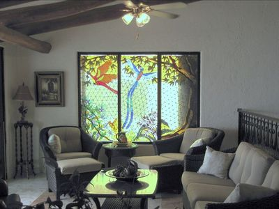 SECOND STORY LIVING ROOM WITH TERRACE ENTRANCE AND STAINED GLASS MURAL WINDOW...