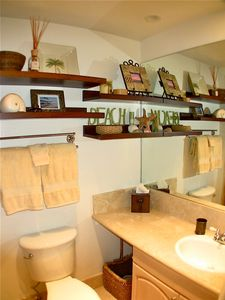 Ocean Beach condo rental - Master bath offers shelves and baskets to stash your stuff!