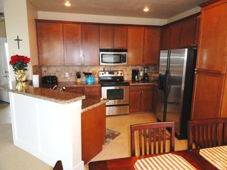 Galveston house photo - spacious kitchen w/ granite & stainless