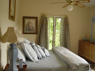 Franklin estate photo - King, corner bedroom with ensuite bath, view of the mountains and treetops