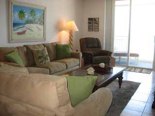 Indian Harbour Beach condo photo - Living room opens onto balcony