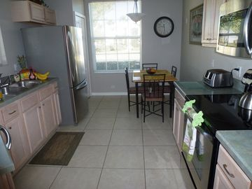 Bright and modern kitchen with new stainless steel appliances.