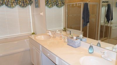 Master bathroom vanity and spa tub