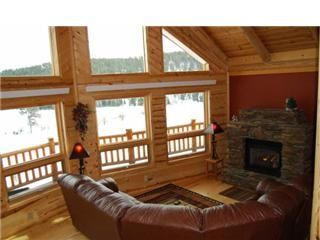 Living Room with fireplace and view of Black Hills