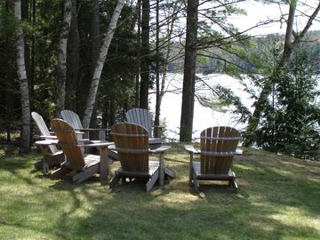 Six adirondack chairs to relax at the water's edge