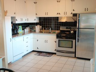 Falmouth house photo - Eat-in Kitchen has gas stove, dishwasher and refrigerator.