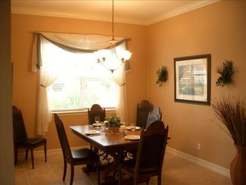 Dining RM table seats up to 8. Adjust the lighting to set your desired ambiance