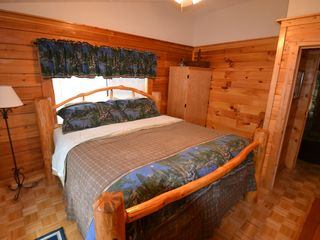 Sevierville cabin photo - Sleep the night away in the log king-sized bed.