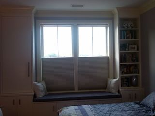 Logan Circle condo photo - Window seat with an abundance of natural light in large bedroom.