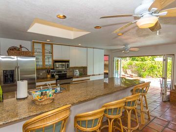 Kitchen has Large Granite Counter, Views & Access to Salt Water Pool